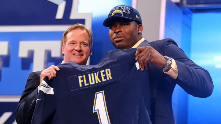 NEW YORK, NY – APRIL 25: D.J. Fluker of the Alabama Crimson Tide stands with NFL Commissioner Roger Goodell (L) as they hold up a jersey on stage after Fluker was picked #11 overall by the San Diego Chargers in the first round of the 2013 NFL Draft at Radio City Music Hall on April 25, 2013 in New York City. (Photo by Al Bello/Getty Images)