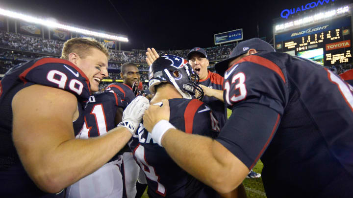 SAN DIEGO, CA – SEPTEMBER 9: Place Kicker Randy Bullock #4 of the Houston Texans is mobbed by J.J. Watt #99 and teammates after his game-winning field goal for a 31-28 final score against of the San Diego Chargers on September 9, 2013 at Qualcomm Stadium in San Diego, California. (Photo by Donald Miralle/Getty Images)
