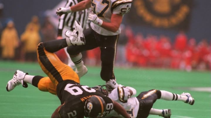 15 JAN 1995: BARRY FOSTER OF THE PITTSBURGH STEELERS IS BROUGHT DOWN BY DARRIEN GORDON OF THE SAN DIEGO CHARGERS DURING THE AFC CHAMPIONSHIP GAME AT THREE RIVERS STADIUM, PITTSBURGH, PENNYSLVANIA. FOLLOWING UP IS CHARGER DENNIS GIBSON ,#57. THE CHARGE