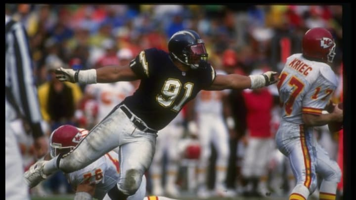 2 Jan 1993: Defensive lineman Leslie O''Neal of the San Diego Chargers goes after Kansas City Chiefs quarterback Dave Kreig during a playoff game at Jack Murphy Stadium in San Diego, California. The Chargers won the game, 17-0.