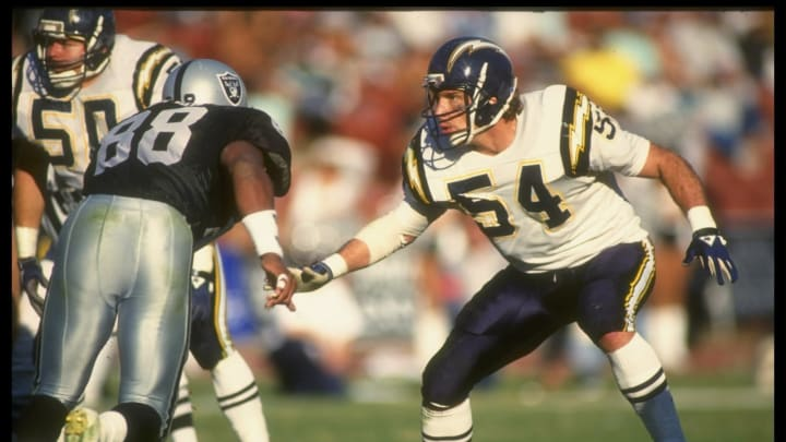 30 Dec 1990: Linebacker Billy Ray Smith of the San Diego Chargers (right) looks on during a game against the Los Angeles Raiders at the Coliseum in Los Angeles, California. The Raiders won the game, 17-12. Mandatory Credit: Mike Powell /Allsport