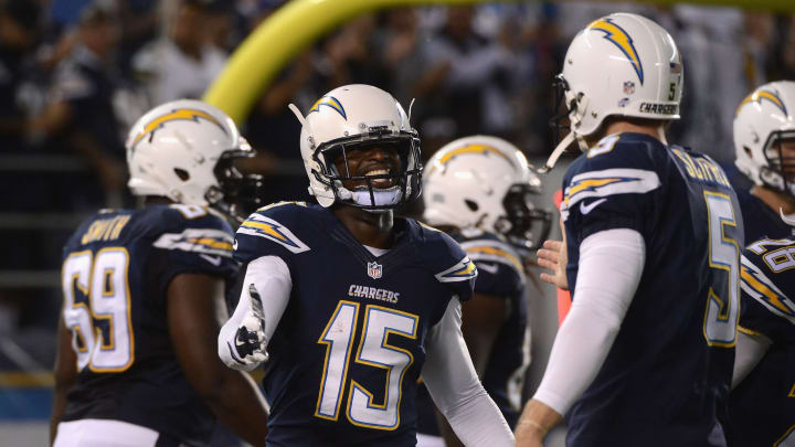 SAN DIEGO, CA – AUGUST 07: Dontrelle Inman #15 of the San Diego Chargers is congratulated by teammate Mike Scifres #5 after scoring a touchdown against the Dallas Cowboys during a preseason game at Qualcomm Stadium on August 7, 2014 in San Diego, California. (Photo by Donald Miralle/Getty Images)