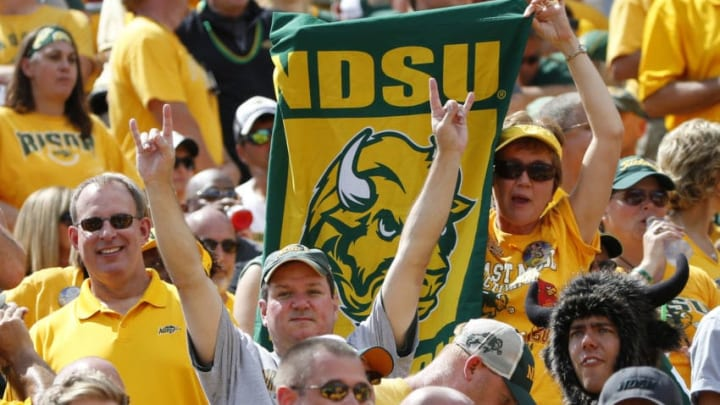 AMES, IA - AUGUST 30: North Dakota Bison fans cheer on their team in the second half of play against the Iowa State Cyclones at Jack Trice Stadium on August 30, 2014 in Ames, Iowa. North Dakota State defeated Iowa State 34-14. (Photo by David Purdy/Getty Images)