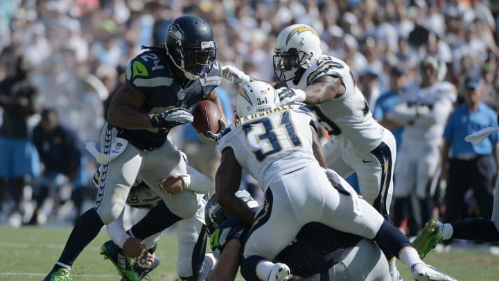 SAN DIEGO, CA – SEPTEMBER 14: Running back Marshawn Lynch #24 of the Seattle Seahawks runs against cornerback Richard Marshall #31 of the San Diego Chargers at Qualcomm Stadium on September 14, 2014 in San Diego, California. (Photo by Donald Miralle/Getty Images)