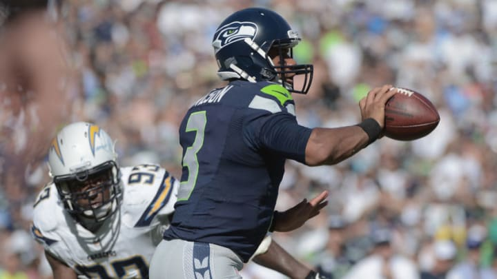 SAN DIEGO, CA - SEPTEMBER 14: Quarterback Russell Wilson #3 of the Seattle Seahawks looks to pass against the San Diego Chargers at Qualcomm Stadium on September 14, 2014 in San Diego, California. (Photo by Donald Miralle/Getty Images)