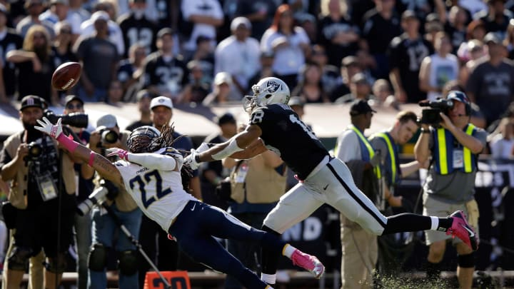 OAKLAND, CA – OCTOBER 12: Jason Verrett #22 of the San Diego Chargers dives but can not catch a pass intended for Andre Holmes #18 of the Oakland Raiders at O.co Coliseum on October 12, 2014 in Oakland, California. (Photo by Ezra Shaw/Getty Images)