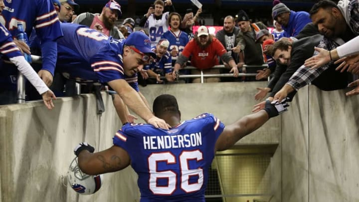 DETROIT, MI - NOVEMBER 24: Seantrel Henderson #66 of the Buffalo Bills celebrates with the fans after the game against the New York Jets at Ford Field on November 24, 2014 in Detroit, Michigan. The Bills defeated the Jets 38-3. (Photo by Leon Halip/Getty Images)
