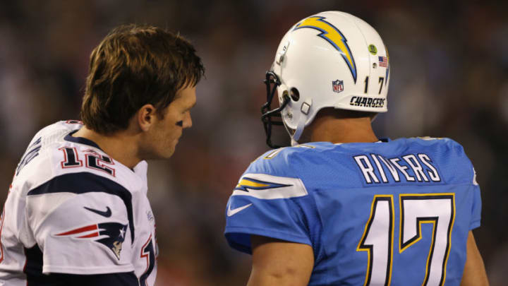 SAN DIEGO, CA - DECEMBER 07: Quarterback Tom Brady #12 of the New England Patriots and quarterback Philip Rivers #17 of the San Diego Chargers talks before their game at Qualcomm Stadium on December 7, 2014 in San Diego, California. (Photo by Todd Warshaw/Getty Images)
