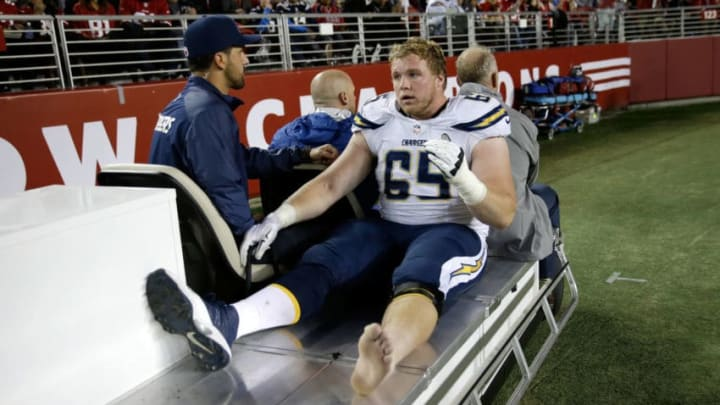 SANTA CLARA, CA - DECEMBER 20: Center Chris Watt #65 of the San Diego Chargers is carted to the locker room after an injury in the first half against the San Francisco 49ers at Levi's Stadium on December 20, 2014 in Santa Clara, California. (Photo by Ezra Shaw/Getty Images)