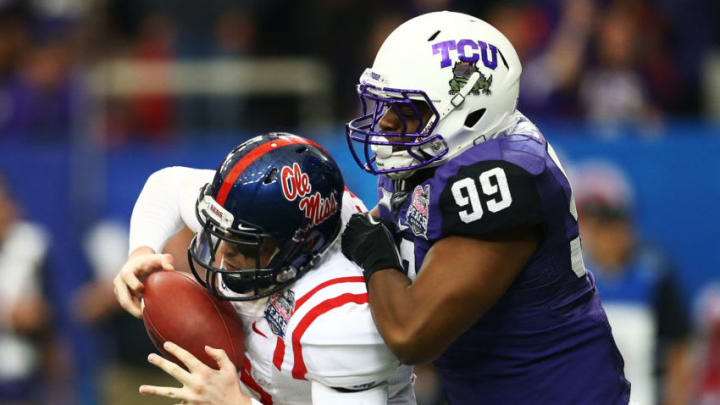 ATLANTA, GA - DECEMBER 31: Tevin Lawson #99 of the TCU Horned Frogs sacks Bo Wallace #14 of the Ole Miss Rebels in the second quarter during the Chik-fil-A Peach Bowl at Georgia Dome on December 31, 2014 in Atlanta, Georgia. (Photo by Streeter Lecka/Getty Images)