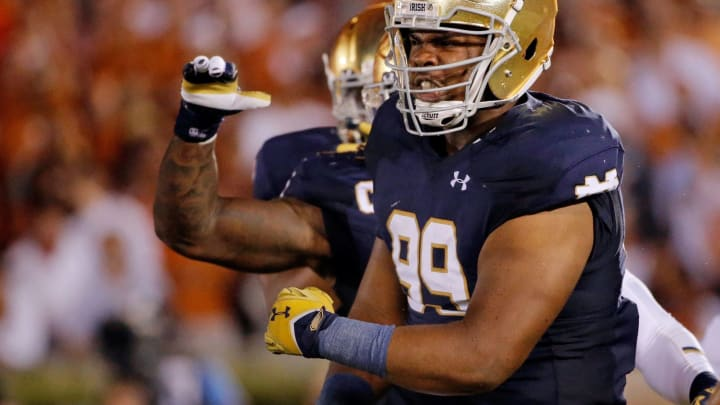 SOUTH BEND, IN – SEPTEMBER 05: Jerry Tillery #99 of the Notre Dame Fighting Irish celebrates after making a tackle against the Texas Longhorns during the second quarter at Notre Dame Stadium on September 5, 2015 in South Bend, Indiana. (Photo by Jon Durr/Getty Images)