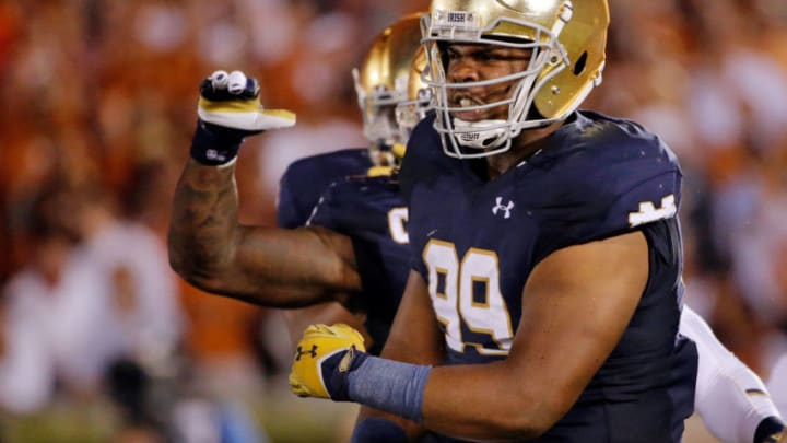 SOUTH BEND, IN - SEPTEMBER 05: Jerry Tillery #99 of the Notre Dame Fighting Irish celebrates after making a tackle against the Texas Longhorns during the second quarter at Notre Dame Stadium on September 5, 2015 in South Bend, Indiana. (Photo by Jon Durr/Getty Images)