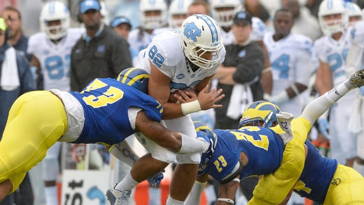 CHAPEL HILL, NC – SEPTEMBER 26: Blaine Woodson #73 and Nasir Adderley #23 of the Delaware Fightin Blue Hens tackle Brandon Fritts #82 of the North Carolina Tar Heels during their game at Kenan Stadium on September 26, 2015 in Chapel Hill, North Carolina. (Photo by Grant Halverson/Getty Images)