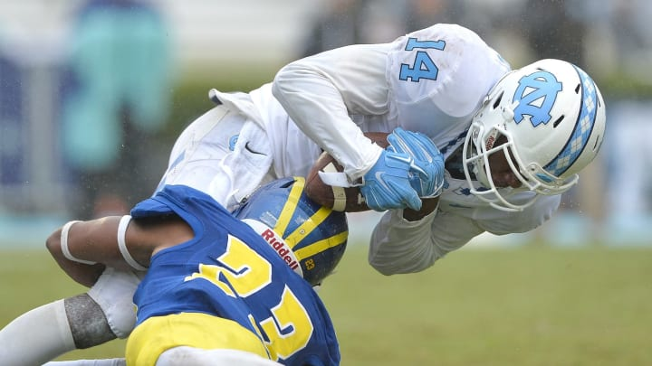 CHAPEL HILL, NC – SEPTEMBER 26: Nasir Adderley #23 of the Delaware Fightin Blue Hens tackles Quinshad Davis #14 of the North Carolina Tar Heels during their game at Kenan Stadium on September 26, 2015 in Chapel Hill, North Carolina. North Carolina won 41-14. (Photo by Grant Halverson/Getty Images)