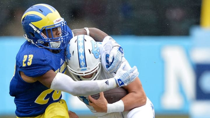 CHAPEL HILL, NC - SEPTEMBER 26: Nasir Adderley #22 of the Delaware Fightin Blue Hens tackles Mitch Trubisky #10 of the North Carolina Tar Heels during their game at Kenan Stadium on September 26, 2015 in Chapel Hill, North Carolina. North Carolina won 41-14. (Photo by Grant Halverson/Getty Images)