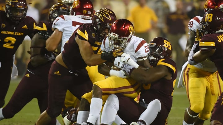 TEMPE, AZ – SEPTEMBER 26: Aca'Cedric Ware #28 of the Southern California Trojans is tackled by Salamo Fiso #58 and Renell Wren #95 of the Arizona State University Sun Devils during the second half at Sun Devil Stadium on September 26, 2015 in Tempe, Arizona. Trojans won 42-14. (Photo by Norm Hall/Getty Images)