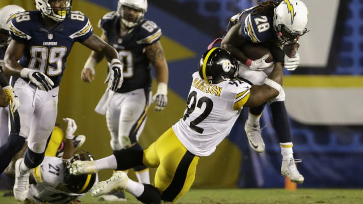 SAN DIEGO, CA – OCTOBER 12: Running back Melvin Gordon #28 of the San Diego Chargers is tackled by outside linebacker James Harrison #92 of the Pittsburgh Steelers at Qualcomm Stadium on October 12, 2015 in San Diego, California. (Photo by Jeff Gross/Getty Images)