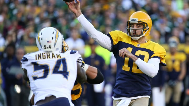 GREEN BAY, WI – OCTOBER 18: Quarterback Aaron Rodgers #12 of the Green Bay Packers throws the football against Melvin Ingram #54 of the San Diego Chargers in the first quarter at Lambeau Field on October 18, 2015, in Green Bay, Wisconsin. (Photo by Jonathan Daniel/Getty Images)