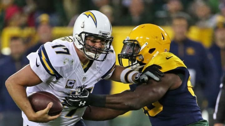 GREEN BAY, WI - OCTOBER 18: Philip Rivers #17 of the San Diego Chargers gets away from Joe Thomas #48 of the Green Bay Packers at Lambeau Field on October 18, 2015 in Green Bay, Wisconsin. The Packers defeated the Chargers 27-20. (Photo by Jonathan Daniel/Getty Images)