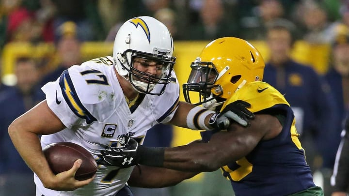 GREEN BAY, WI – OCTOBER 18: Philip Rivers #17 of the San Diego Chargers gets away from Joe Thomas #48 of the Green Bay Packers at Lambeau Field on October 18, 2015 in Green Bay, Wisconsin. The Packers defeated the Chargers 27-20. (Photo by Jonathan Daniel/Getty Images)