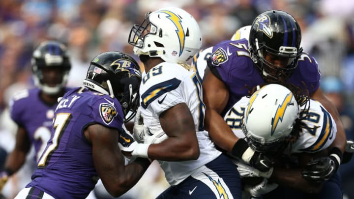 BALTIMORE, MD - NOVEMBER 1: Running back Melvin Gordon #28 of the San Diego Chargers is tackled by inside linebacker Daryl Smith #51 of the Baltimore Ravens while tight end Ladarius Green #89 of the San Diego Chargers blocks tackle De'Ondre Wesley #77 of the Baltimore Ravens in the first quarter of a game at M&T Bank Stadium on November 1, 2015 in Baltimore, Maryland. (Photo by Matt Hazlett/Getty Images)