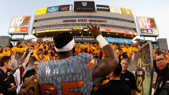 TEMPE, AZ – NOVEMBER 21: Defensive lineman Renell Wren #95 of the Arizona State Sun Devils celebrates as he walks off the field after defeating the Arizona Wildcats 52-37 in the college football game at Sun Devil Stadium on November 21, 2015 in Tempe, Arizona. (Photo by Christian Petersen/Getty Images)