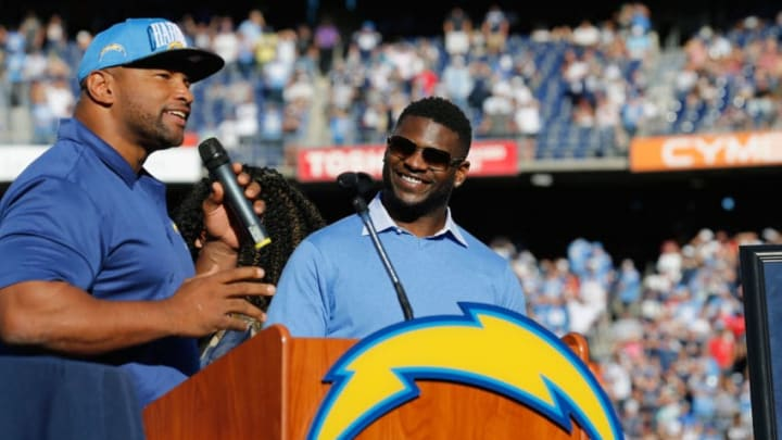 SAN DIEGO, CA - NOVEMBER 22: Former NFL Player LaDanian Tomlinson is introduced by former NFL player Lorenzo Neal to have his number retired by the San Diego Chargers during halftime of a game against the Kansas City Chiefs at Qualcomm Stadium on November 22, 2015 in San Diego, California. (Photo by Sean M. Haffey/Getty Images)
