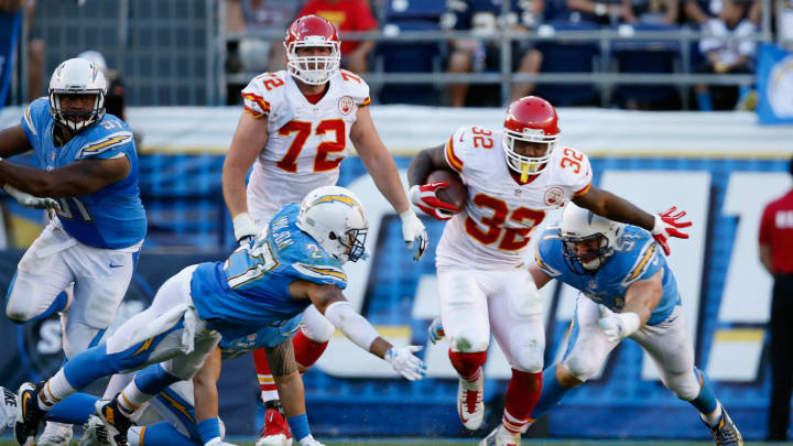 SAN DIEGO, CA – NOVEMBER 22: Spencer Ware #32 of the Kansas City Chiefs eludes Jimmy Wilson #27 of the San Diego Chargers and Kyle Emanuel #51 of the San Diego Chargers during a game at Qualcomm Stadium on November 22, 2015 in San Diego, California. (Photo by Sean M. Haffey/Getty Images)