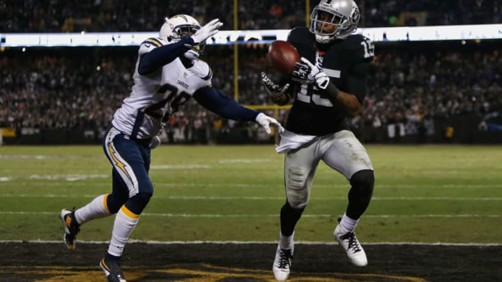 OAKLAND, CA - DECEMBER 24: Wide receiver Michael Crabtree #15 of the Oakland Raiders catches a touchdown ahead of corner back Craig Mager #29 of the San Diego Chargers in the third quarter at O.co Coliseum on December 24, 2015 in Oakland, California. (Photo by Lachlan Cunningham/Getty Images)