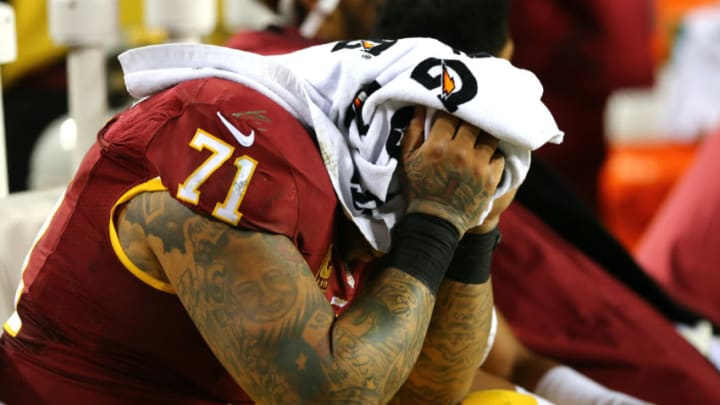 LANDOVER, MD - JANUARY 10: Tackle Trent Williams #71 of the Washington Redskins covers his face with a towel against the Green Bay Packers in the fourth quarter during the NFC Wild Card Playoff game at FedExField on January 10, 2016 in Landover, Maryland. (Photo by Elsa/Getty Images)