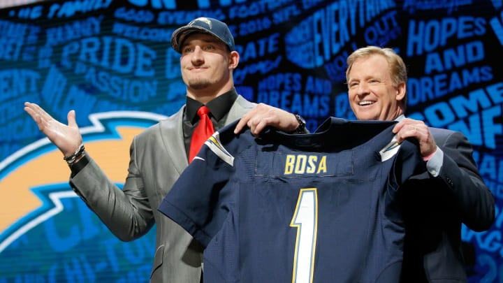 CHICAGO, IL – APRIL 28: (L-R) Joey Bosa of Ohio State holds up a jersey with NFL Commissioner Roger Goodell after being picked