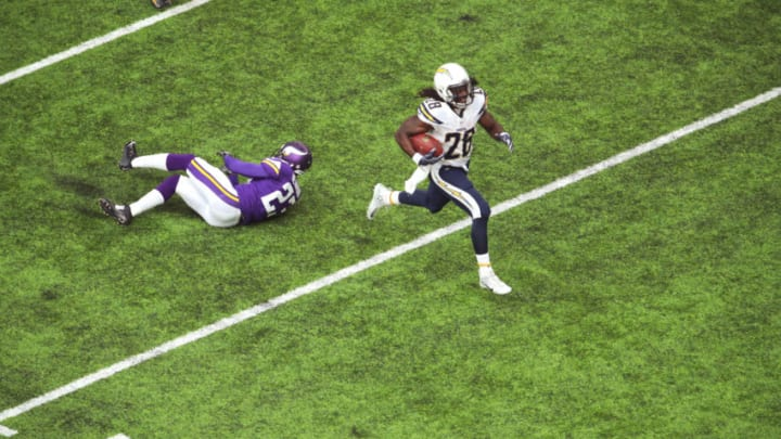 MINNEAPOLIS, MN - AUGUST 28: Melvin Gordon #28 of the San Diego Chargers avoids the tackle of Terence Newman #23 of the Minnesota Vikings for a touchdown in the second quarter at U.S. Bank Stadium on August 28, 2016 in Minneapolis, Minnesota. (Photo by Adam Bettcher/Getty Images)