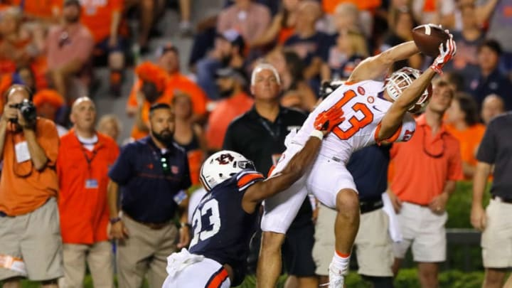 AUBURN, AL - SEPTEMBER 03: Hunter Renfrow #13 of the Clemson Tigers scores a touchdown during the fourth quarter against Johnathan Ford #23 of the Auburn Tigers at Jordan Hare Stadium on September 3, 2016 in Auburn, Alabama. (Photo by Kevin C. Cox/Getty Images)