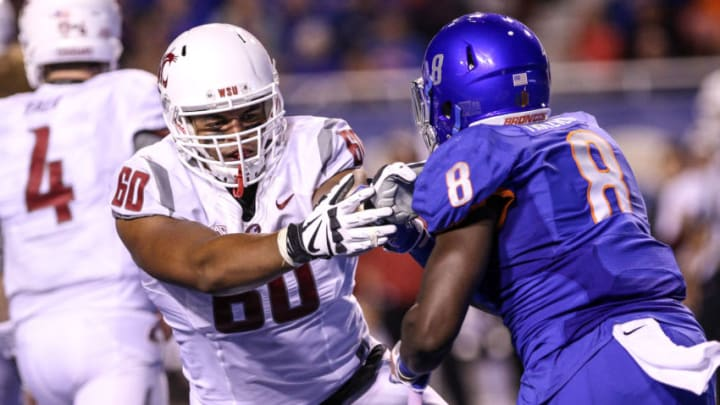 BOISE, ID - SEPTEMBER 10: Offensive lineman Andre Dillard #60 of the Washington State Cougars battles defensive end Jabril Frazier #8 of the Boise State Broncos during second half action on September 10, 2016 at Albertsons Stadium in Boise, Idaho. Boise State won the game 31-28. (Photo by Loren Orr/Getty Images)