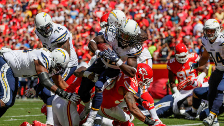 KANSAS CITY, MO - SEPTEMBER 11: Running back Melvin Gordon #28 of the San Diego Charger fights through tackle of inside linebacker Derrick Johnson #56 of the Kansas City Chiefs to score the games first touchdown during the first quarter at Arrowhead Stadium during the game on September 11, 2016 in Kansas City, Missouri. (Photo by Jamie Squire/Getty Images)