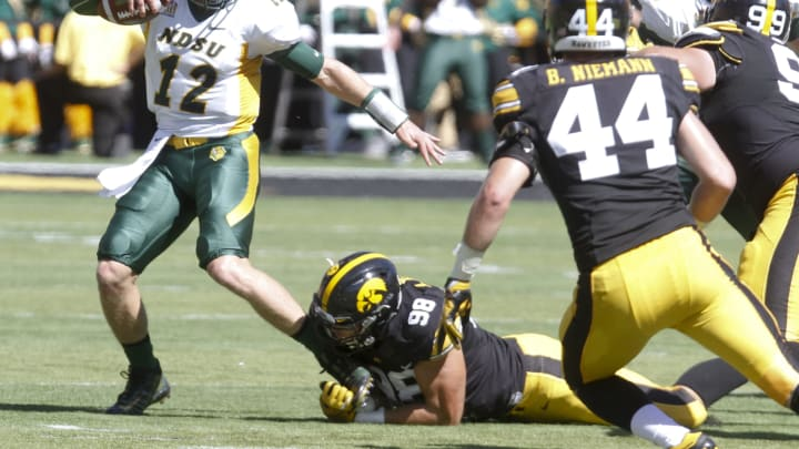 IOWA CITY, IOWA- SEPTEMBER 17: Defensive end Anthony Nelson #98 of the Iowa Hawkeyes grabs the ankle of quarterback Easton Stick #12 of the North Dakota State Bisons in the second quarter, on September 17, 2016 at Kinnick Stadium in Iowa City, Iowa. (Photo by Matthew Holst/Getty Images)