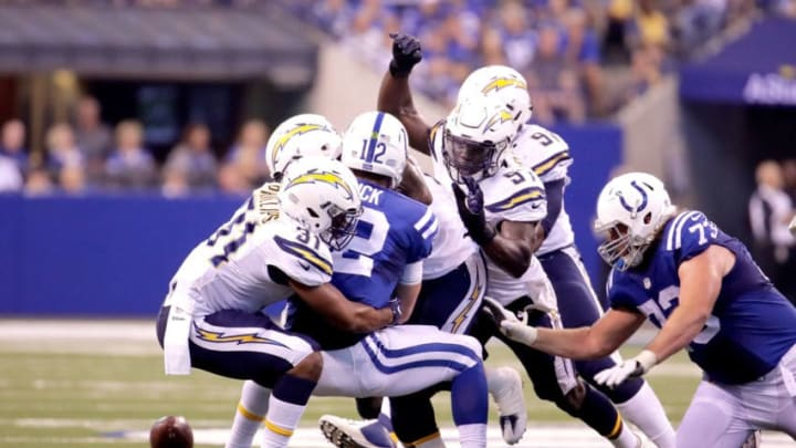 INDIANAPOLIS, IN - SEPTEMBER 25: Andrew Luck #12 of the Indianapolis Colts fumbles the ball during the second half of the game against the San Diego Chargers at Lucas Oil Stadium on September 25, 2016 in Indianapolis, Indiana. (Photo by Andy Lyons/Getty Images)