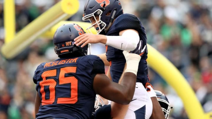 EAST RUTHERFORD, NJ - OCTOBER 01: Eric Dungey #2 of the Syracuse Orange celebrates his touchdown with teammate Jamar McGloster #65 in the first quarter against the Notre Dame Fighting Irish at MetLife Stadium on October 1, 2016 in East Rutherford, New Jersey. (Photo by Elsa/Getty Images)