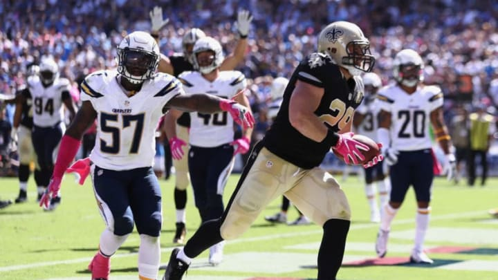 SAN DIEGO, CA - OCTOBER 02: Jatavis Brown #57 of the San Diego Chargers pursues John Kuhn #29 of the New Orleans Saints as Kuhn scores a touchdown against the San Diego Chargers in the first half at Qualcomm Stadium on October 2, 2016 in San Diego, California. (Photo by Sean M. Haffey/Getty Images)