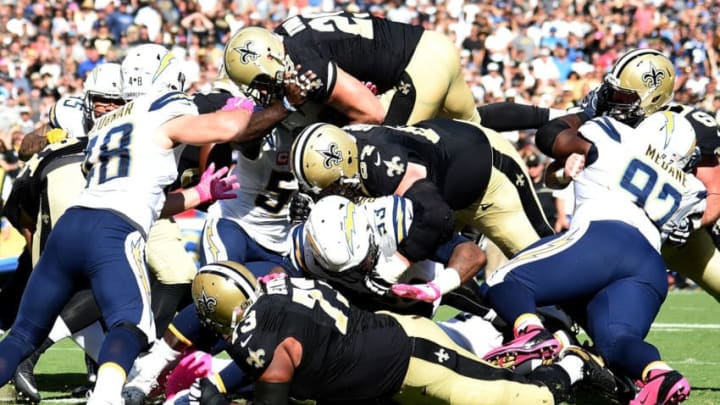 SAN DIEGO, CA - OCTOBER 02: John Kuhn #29 of the New Orleans Saints goes over the top to score a touchdown to trail 21-24 to the San Diego Chargers during the third quarter at Qualcomm Stadium on October 2, 2016 in San Diego, California. (Photo by Harry How/Getty Images)