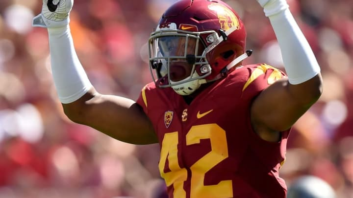 LOS ANGELES, CA - OCTOBER 08: Uchenna Nwosu #42 of the USC Trojans celebrates his blocked pass during the first quarter against the Colorado Buffaloes at Los Angeles Memorial Coliseum on October 8, 2016 in Los Angeles, California. (Photo by Harry How/Getty Images)