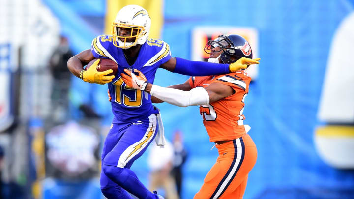 SAN DIEGO, CA – OCTOBER 13: Dontrelle Inman #15 of the San Diego Chargers fends off Chris Harris #25 of the Denver Broncos as he runs after his catch during the first quarter at Qualcomm Stadium on October 13, 2016 in San Diego, California. (Photo by Harry How/Getty Images)
