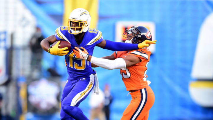 SAN DIEGO, CA - OCTOBER 13: Dontrelle Inman #15 of the San Diego Chargers fends off Chris Harris #25 of the Denver Broncos as he runs after his catch during the first quarter at Qualcomm Stadium on October 13, 2016 in San Diego, California. (Photo by Harry How/Getty Images)