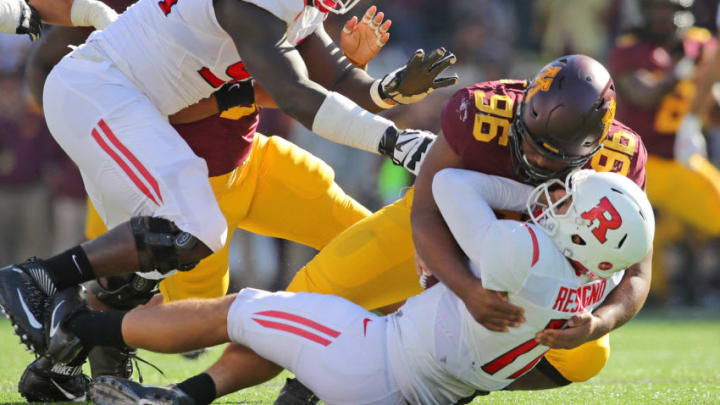 MINNEAPOLIS, MN - OCTOBER 22: Steven Richardson #96 of the Minnesota Golden Gophers sacks Giovanni Rescigno #17 of the Rutgers Scarlet Knights in the second quarter at TCF Bank Stadium on October 22, 2016 in Minneapolis, Minnesota. (Photo by Adam Bettcher/Getty Images)