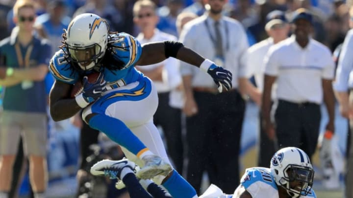 SAN DIEGO, CA - NOVEMBER 06: Melvin Gordon #28 of the San Diego Chargers runs past Perrish Cox #20 of the Tennessee Titans in the first half at Qualcomm Stadium on November 6, 2016 in San Diego, California. (Photo by Sean M. Haffey/Getty Images)