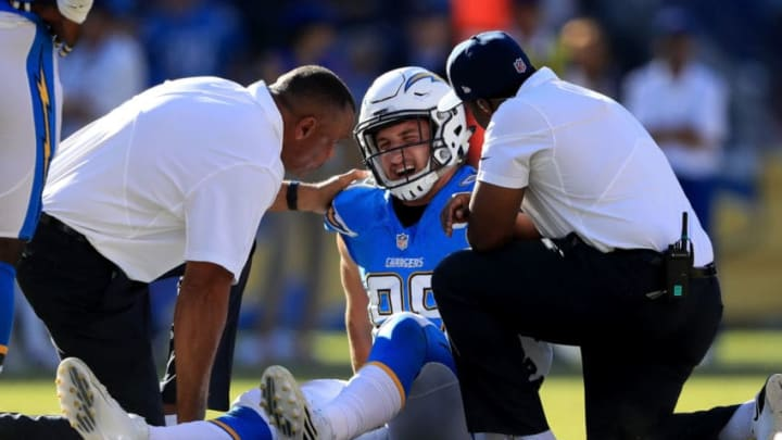 SAN DIEGO, CA - NOVEMBER 06: Team staff check out Joey Bosa #99 of the San Diego Chargers during the first half of a game against the Tennessee Titans at Qualcomm Stadium on November 6, 2016 in San Diego, California. (Photo by Sean M. Haffey/Getty Images)