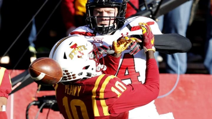 AMES, IA - NOVEMBER 19: Defensive back Brian Peavy #10 of the Iowa State Cyclones breaks up a pass meant for wide receiver Dylan Cantrell #14 of the Texas Tech Red Raiders in the first half of play at Jack Trice Stadium on November 19, 2016 in Ames, Iowa. (Photo by David Purdy/Getty Images)