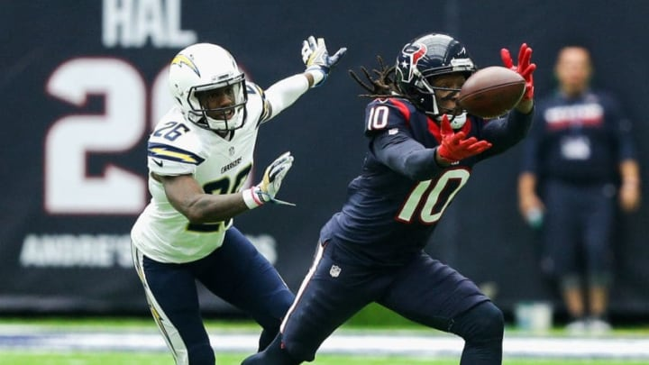 HOUSTON, TX - NOVEMBER 27: DeAndre Hopkins #10 of the Houston Texans tips the ball back to himself as Casey Hayward #26 of the San Diego Chargers defends at NRG Stadium on November 27, 2016 in Houston, Texas. (Photo by Bob Levey/Getty Images)