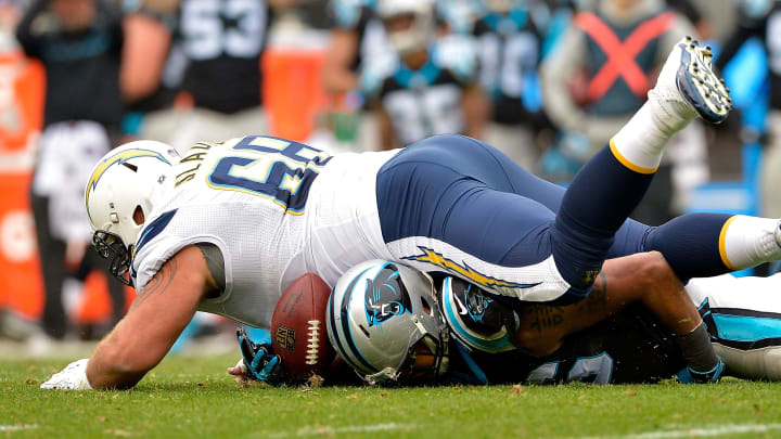 CHARLOTTE, NC – DECEMBER 11: Matt Slauson #68 of the San Diego Chargers breaks up a turnover opportunity by Wes Horton #96 of the Carolina Panthers in the second quarter during the game at Bank of America Stadium on December 11, 2016 in Charlotte, North Carolina. (Photo by Grant Halverson/Getty Images)