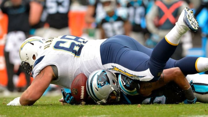 CHARLOTTE, NC - DECEMBER 11: Matt Slauson #68 of the San Diego Chargers breaks up a turnover opportunity by Wes Horton #96 of the Carolina Panthers in the second quarter during the game at Bank of America Stadium on December 11, 2016 in Charlotte, North Carolina. (Photo by Grant Halverson/Getty Images)